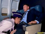Stewardess becomes passenger's personal hospitality attendant and man fucks brunette in the cabin 5
