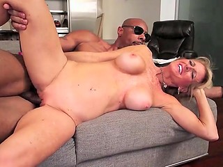 Blonde mature woman is fucked in vagina by big black cock that erupts cum on her face