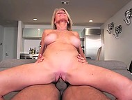 Blonde mature woman is fucked in vagina by big black cock that erupts cum on her face 5
