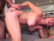 Blonde mature woman is fucked in vagina by big black cock that erupts cum on her face 8