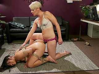 Short-haired cougar dominates over Asian mistress by tying her up and penetrating with strapon
