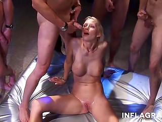 Light-haired German whore with wonderful big tits has no problem with gangbang