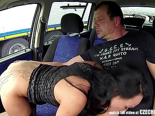 Man makes a deal with Czech hooker and parks between trucks to fuck her in the back seat