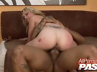College girl with tie around the neck sucks big black cock and enjoys interracial fuck riding it