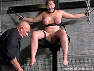 Man tortures innocent chubby making her face express pain when he snaps the rubber on her numb hooters 10