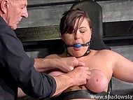 Man tortures innocent chubby making her face express pain when he snaps the rubber on her numb hooters 5