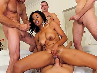 Eight male hands massage Ebony chick and she has interracial sex in gangbang video