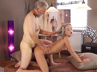 Grey-haired stallion with beard fucks young blonde from behind and she is in seventh heaven