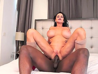 Raven-haired mature woman with big tits wants to see black stallion's cock and take it in cunt