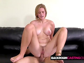 Blonde newcomer with natural assets and agent copulate in backroom until he creams her trimmed twat