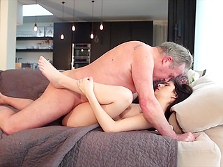 Old man is cold a little bit and eye-catching young lover quickly warms him by sex on the couch