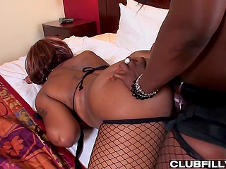 Imperious black woman dominates over submissive mistress with help of strapon and dildo