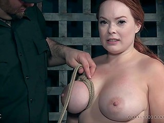 Ginger pornstar can't run away because of chains and man wraps her boobs with rope