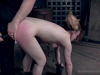 Submissive redhead with perky tits dominated by mysterious guy who adores to use various devices