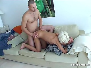 Tanned platinum blonde with eyebrow piercing has doggystyle sex and rides cock with pussy