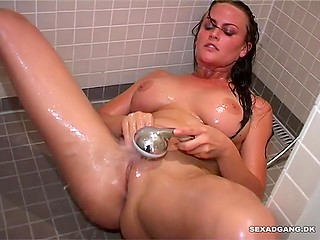 Seductive brunette lady with big chest shows how she masturbates pussy in the shower room