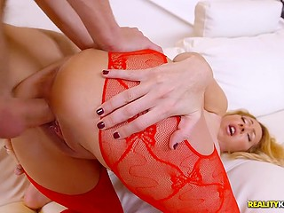Stunning blonde woman in red stockings takes young guy home and enjoys doggystyle sex
