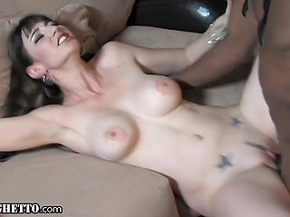 Gorgeous brunette with big breasts sucks black cock to make it hard and guy fucks her pussy