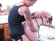 Merciless lesbians Aiden Starr and Dana Vespoli use strapon to fuck tied up girl in bathroom 7