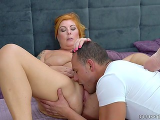 Red-haired sexy granny Tammy Jean still in good shape to have fun with much younger partner