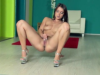 Czech brunette Melisa Mendiny with sexy body teases spectators masturbating on the floor