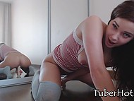 Young webcam model in grey over-the-knee socks receives pleasure riding dildo with vagina