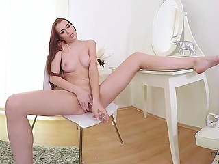 Pleasant chick with red hair prepares for a date and decides to play with pussy a little bit