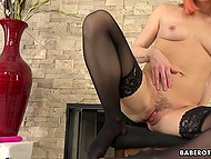 Red-haired hottie in black stockings Carter Cruise moans while gently fingering own trimmed peach 5