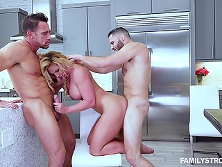 Sexy MILF Phoenix Marie celebrates Independence Day with a bang having threesome in the kitchen