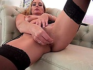 Stunning blonde MILF in black stockings seductively undresses and gently touches own snatch 8