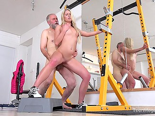 Old man helps young blonde Martina D with stretching and this leads to unplanned affair in empty gym