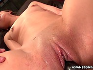Japanese perverts dominate over tied up sweetheart by fingering and stuffing her bald cunny with toys 4