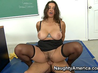 Full-bosomed teacher Persia Monir in stockings satisfies sexual needs riding a young penis