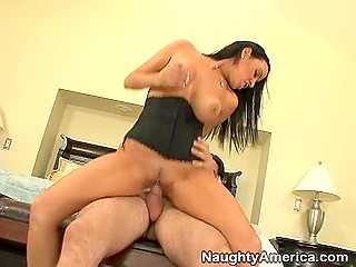 Dark-haired bitch Vanilla DeVille in corset cheats on husband riding his friend's cock