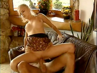 Excited blonde joined on sofa by skillful bruiser who in no time buries bulge into her moist vagina