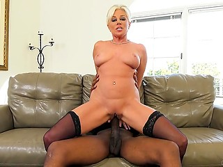 Blonde MILF has a lot of cocks inside womb but this one is the biggest in her pussy
