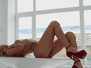 Striptease by slender XXX model Evgenia Pavlova in black panties and red high heels