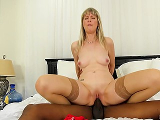 Big black cock is something new for an experienced pornstar in flesh-colored stockings
