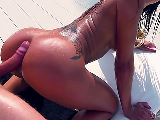 Tanned girl with sunglasses is lying in the sun and having anal sex with lavish beau