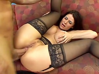Fascinating black-haired MILF Eva Karera gets her face covered with cum after double penetration