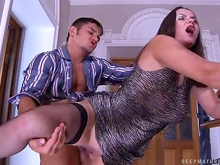 Young Russian guy fucks sexy mature in black stockings