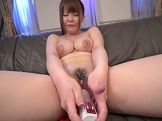 Attractive Japanese girl with huge natural boobs loves toying her oiled up and trimmed snatch