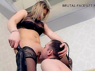 Busty Russian mistress wearing black stockings and high heels mocks guy with collar