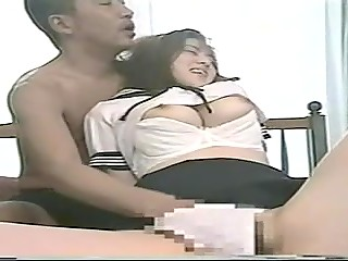 Cute Japanese lady with big melons isn't ashamed of cunnilingus on the table