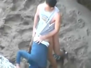 Amateur outdoor video shows fast fucking with two young teen couple on the beach