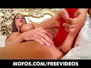 Delicious brunette toying her pussy with long red dildo