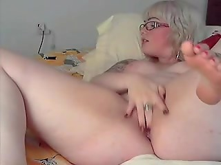 Really cute blonde BBW performs self-fuck with her own red dildo on the webcam