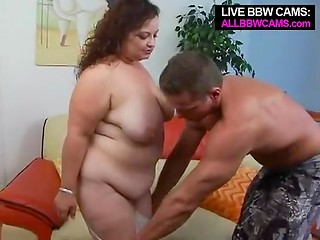 Dark-haired MILF with colossal titties gives first-class blowjob her rich boyfriend