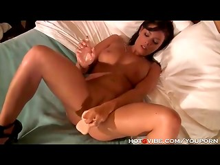 Big realistiс dildo with balls makes this dark-haired lady squirting on her own bed