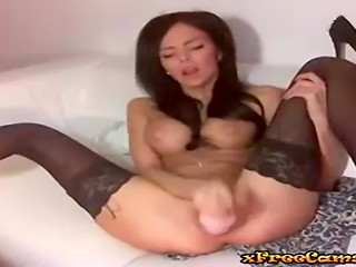 Beautiful busty brunette toys her soaking pussy on webcam